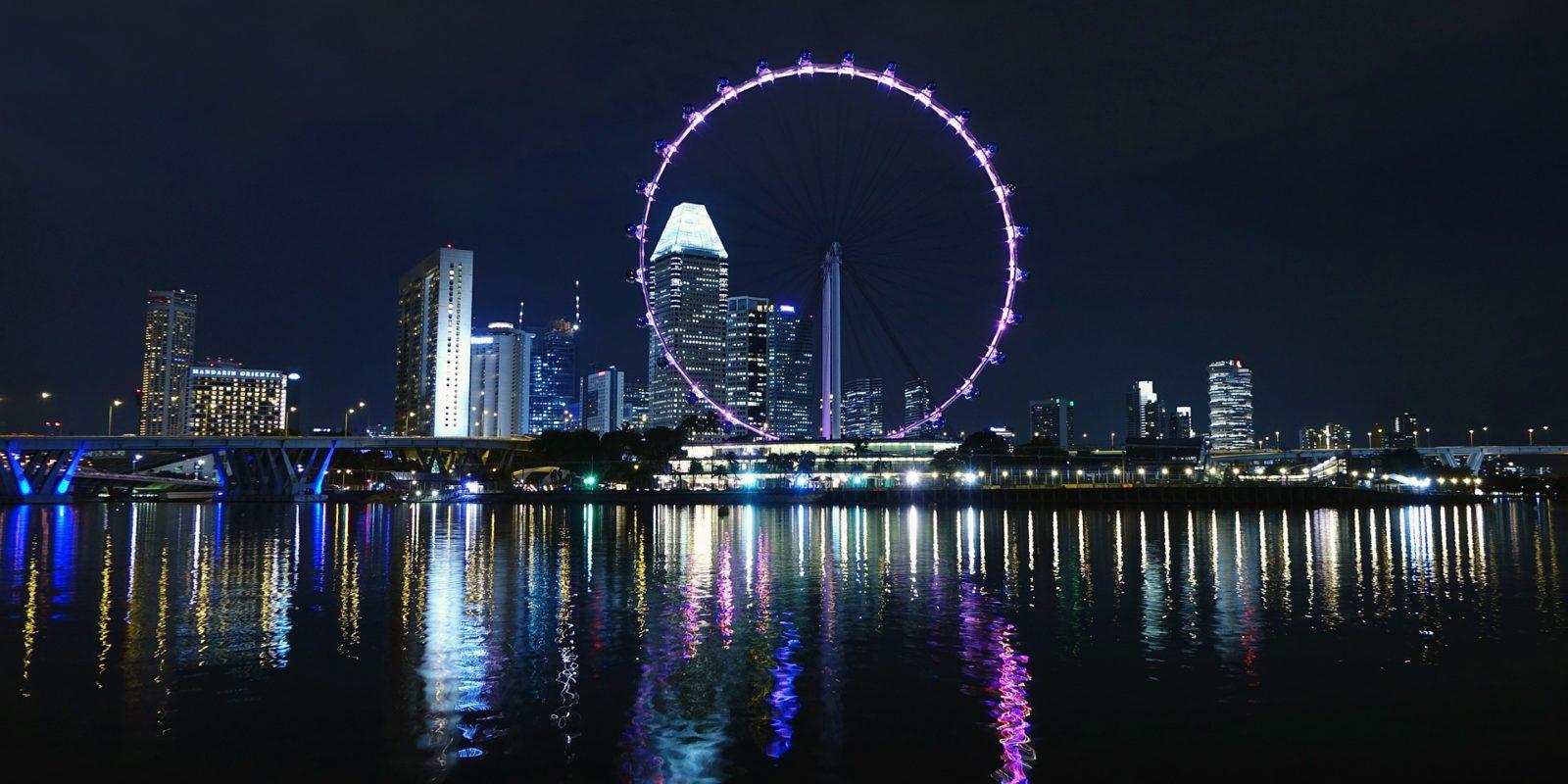 Singapore night skyline with Big Ferris Wheel