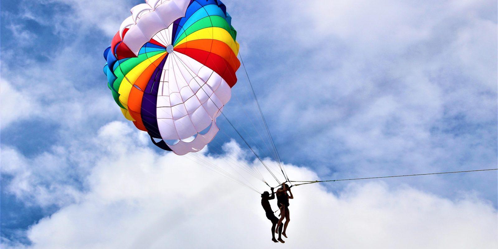 Couple parasailing, Phuket, Thailand.